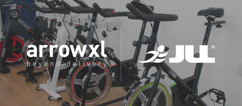 Image of exercise bikes with ArrowXL and JLL Fitness logos